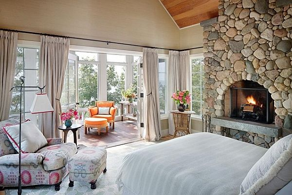 lake house bedroom with fireplace and colorful reading nook decoist