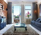 One Bedroom Apartment Stockholm 1 - living room with brick walls