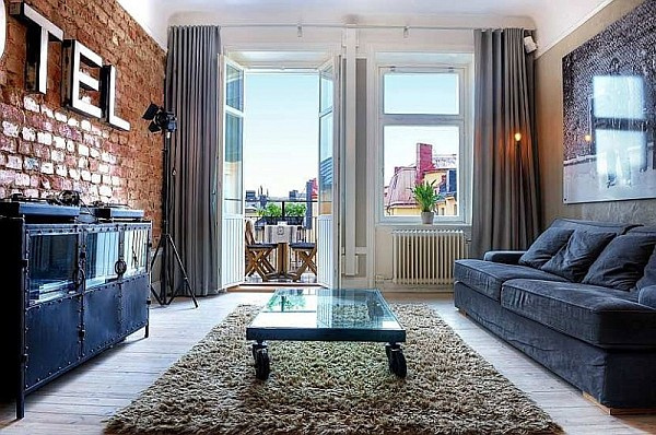 One Bedroom Apartment Stockholm 1 – living room with brick walls