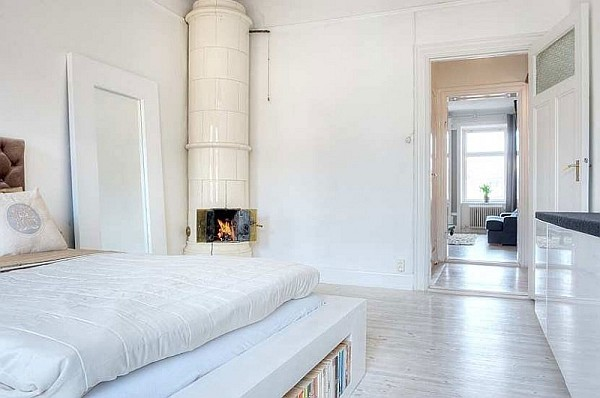 One Bedroom Apartment Stockholm 7 – white bedroom design with fireplace