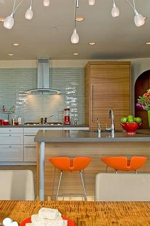Sleek modern kitchen with neon colors and modern bar stools