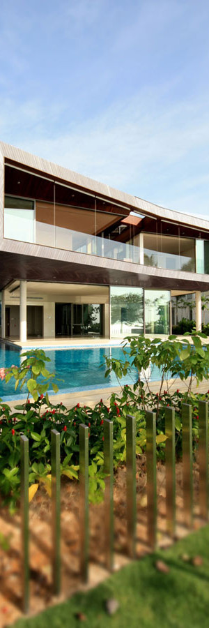 Stereoscopic House Singapore 1 - glass windows house with suspended volume