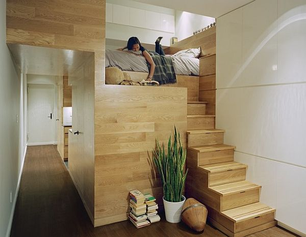 Studio loft stairs with hidden drawers and reading nook