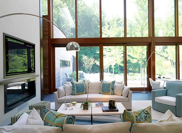 airy modern Living room arrangement white couch and fancy fireplace