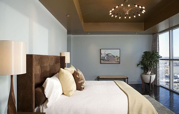 Bedroom With Brown Headboard And Brown Ceiling