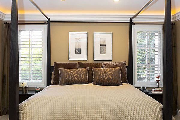 bedroom with uplights used above crown moulding decoist