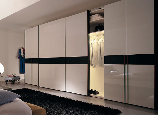 Modern sliding doors wardrobes adding style to your bedroom for Back painted glass designs for wardrobe
