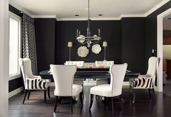 black white and grey living room decor with striped chairs and large