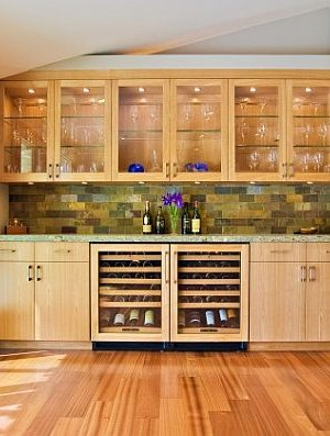 built-in with wine storage and custom cabinets in wooden kitchen with hardwood floors