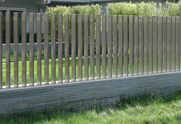 cantilevered steel fence on stone base
