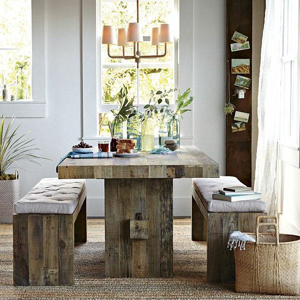 clear glass vase centerpiece on massive wood dining table