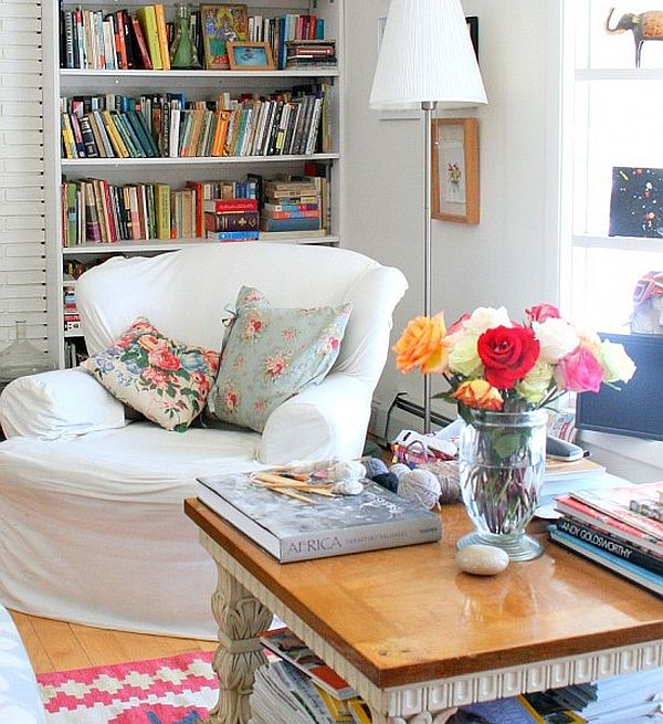 colorful reading area with white slip covers and floral contrasting cushions