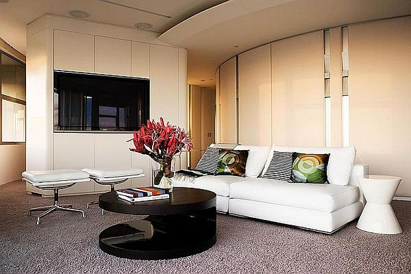 contemporary living room with white leather couch and black coffee table