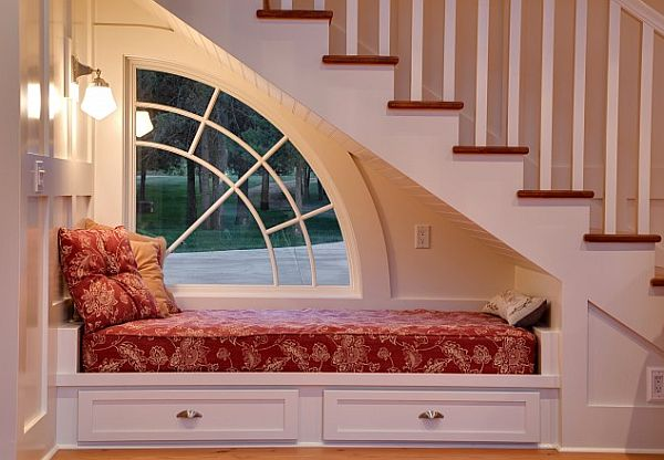 cool under staircase white and red reading nook idea