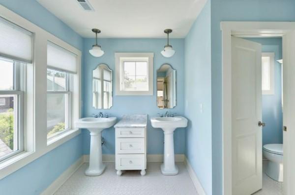 double pedestal sinks in blue bathroom