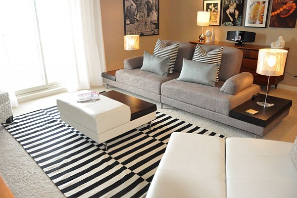elegant living room with sofa and striped rugs
