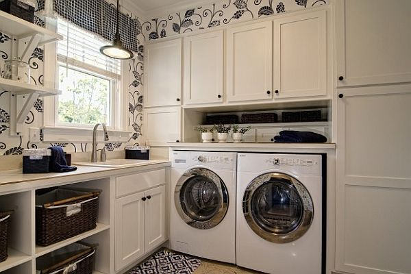 floral wallpaper laundry room with laundry sorter baskets