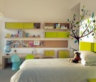 green and white kids bedroom with floral wallpaper