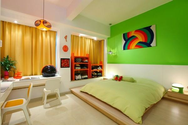 green modern bedroom with rainbow art