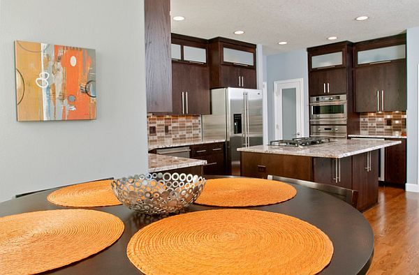 View in gallery Modern kitchen with brown furniture and orange accents
