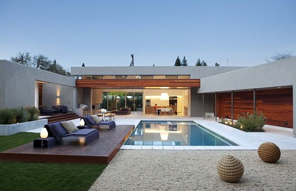 lap pool with raised deck and house view