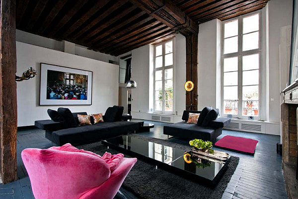 large living room with black sofa and pink lounge