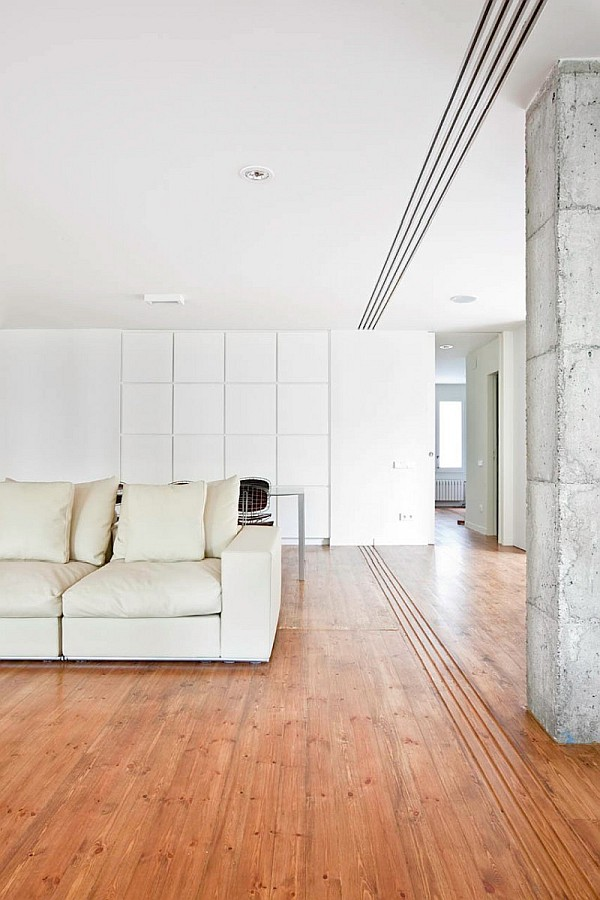 living room couch Revamped Spanish Home Exudes Simplicity and Style: Bonanova Apartment