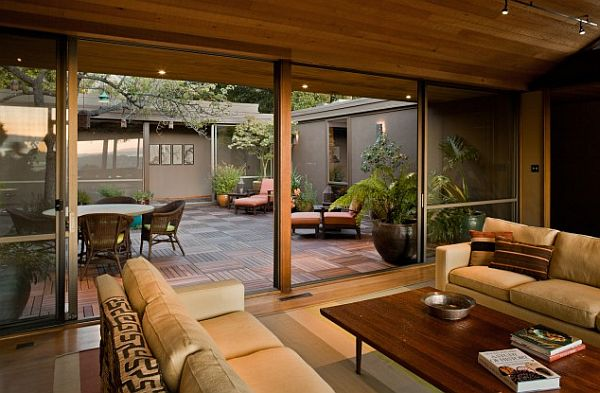 living room with outdoor area and dining table