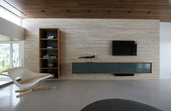 Minimalist Living Room With Stone Wall And Luxury Furniture