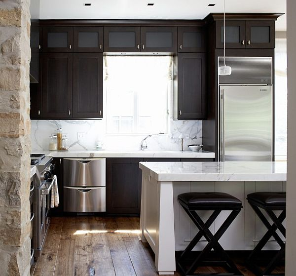 Modern kitchen with stone walls white island and dark for Dark walls in kitchen