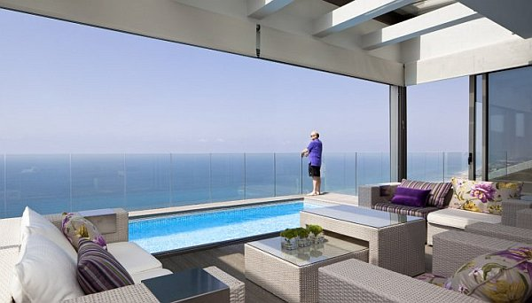 outdoor patio furniture at the pool Netanya Penthouse in Israel Has Amazing Panoramic Mediterranean Sea Views & Luxury Decor