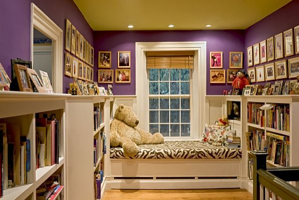 purple and white kids room with large bookcase