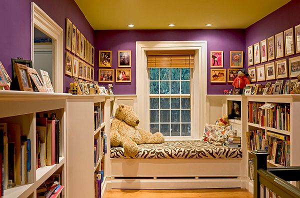 purple-teen-room-with-bookcase-and-framed-pictures-on-the-eall