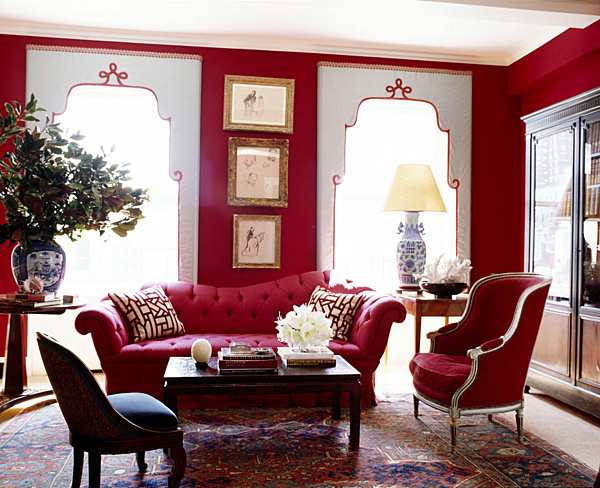In another traditional space ruby tones permeate the room yet the