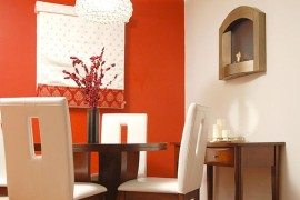 red wall dining room with sleek wooden table