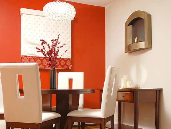 red wall dining room with sleek wooden table Red Branding: Four Powerful Ways to Infuse Your Home With Red