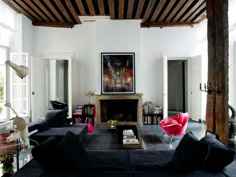 retro inspired living room with fireplace and black touches