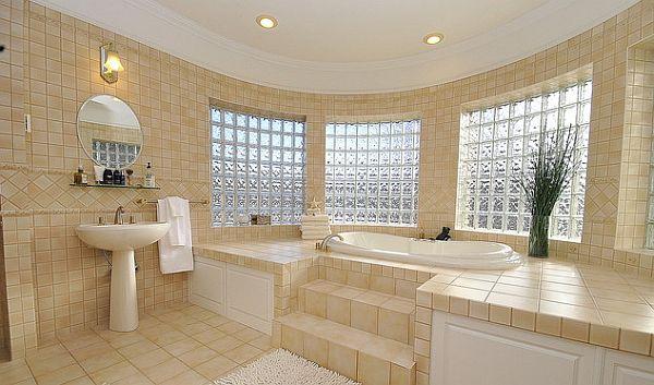 sleek pedestal sink in mediterranean inspired bathroom
