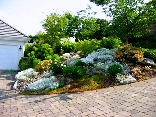 20 fabulous rock garden design ideas for Sloping garden design ideas