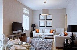 small living room design with white couch and elegant accessories