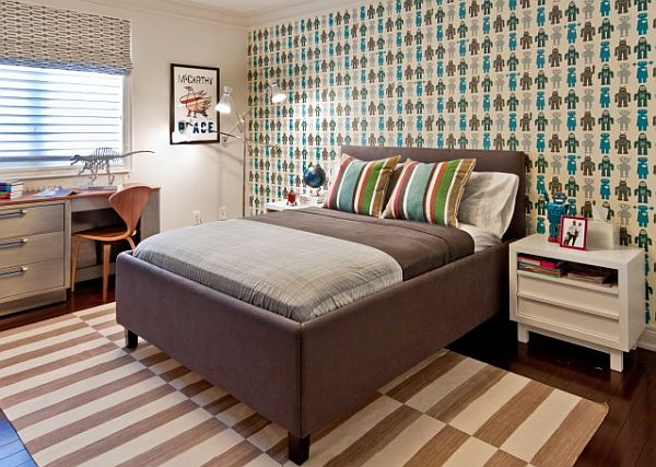 teen boys bedroom with patterned wallpaper and bed coverings