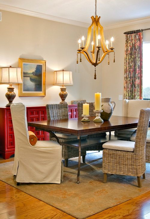 traditional dining room with red cabinets
