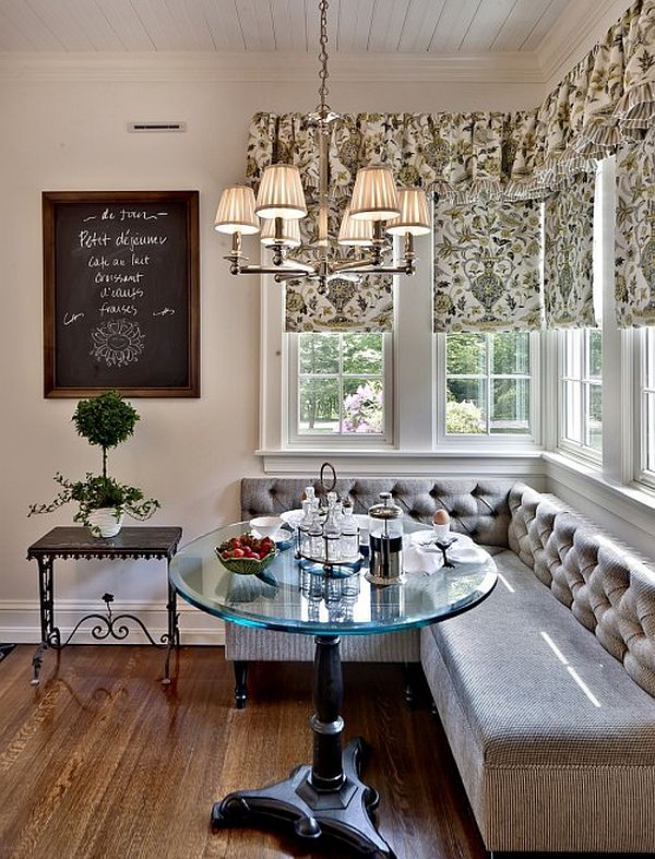 A builtin banquette is flanked by tall glass cabinets for