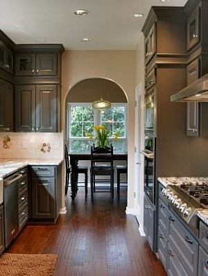 traditional modern kitchen cabinetry in grey with marble countertops