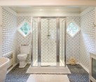 white bathroom with grey tile grout