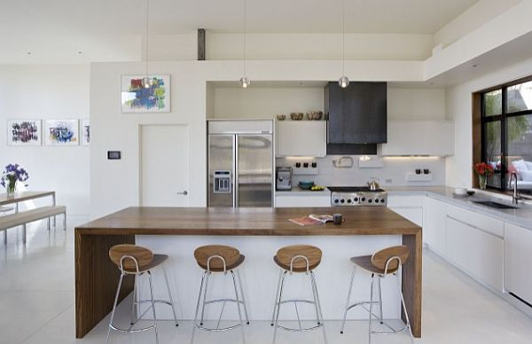 white kitchen with Concreteworks countertops, backsplash and floor