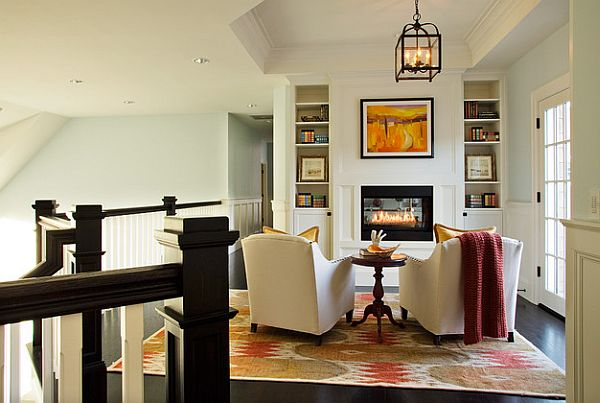 Cozy and bright sitting room with fancy fireplace