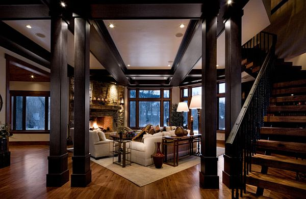 Cozy Dark Living Room With Wooden Beams And Staircase