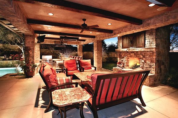 Cozy outdoor furniture setup with warm fireplace