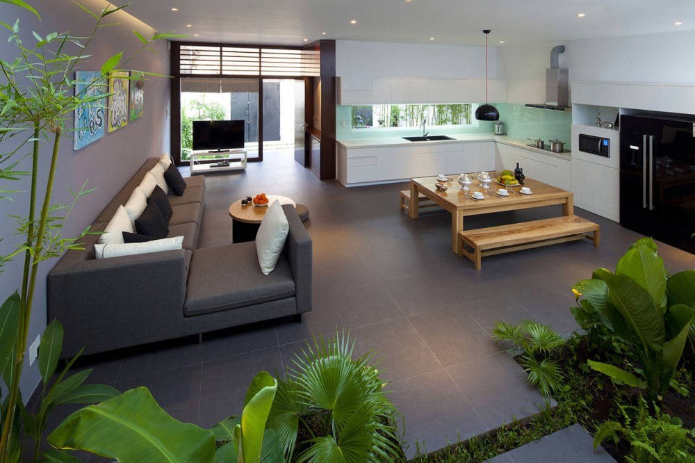 Go Vap Modern House – dining room with glossy furniture and small garden